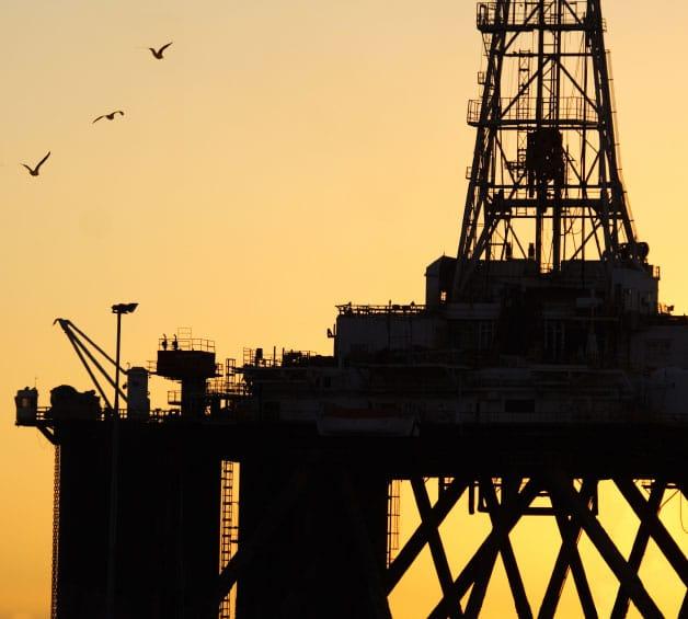 offshore oil platform in sunset